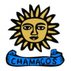 "Chamacos logo shows a drawing of a sun with a face on it, and beneath this, a scroll with the word ""chamacos"""