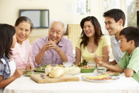 A mulit-generational family of Asian-Americans sharing a meal